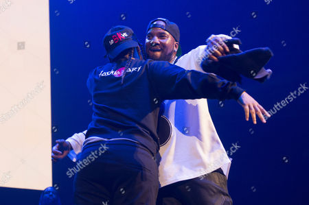 Rappers Young M.A., left, and Young Jeezy share a hug on stage at Power 105.1's Powerhouse 2016 at Barclays Center, in Brooklyn, New York