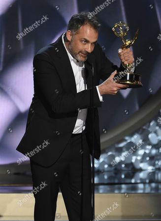 Miguel Sapochnik accepts the award for outstanding directing for a drama series for Game of Thrones at the 68th Primetime Emmy Awards, at the Microsoft Theater in Los Angeles
