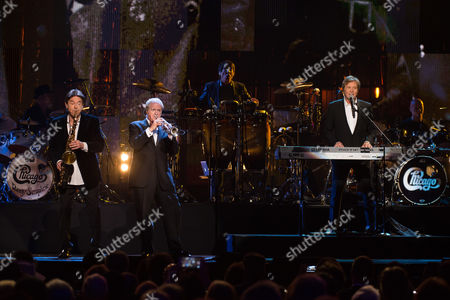 Walter Parazaider, left, Lee Loughnane and Robert Lamm from Chicago perform at the 31st Annual Rock and Roll Hall of Fame Induction Ceremony at the Barclays Center, in New York