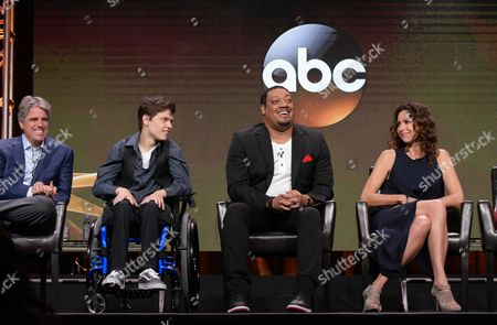 "Writer/producer Scott Silveri, from left, Micah Fowler, Cedric Yarbrough and Minnie Driver participates in the ""Speechless"" panel during the Disney/ABC Television Critics Association summer press tour, in Beverly Hills, Calif"