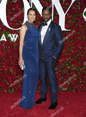 Desiree DaCosta, left, and Blair Underwood, wearing a silver ribbon, arrive at the Tony Awards at the Beacon Theatre, in New York