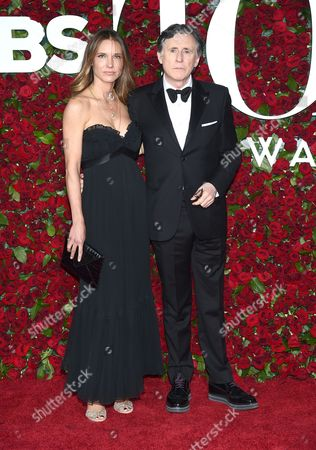 Stock Image of Hannah Beth King, left, and Gabriel Byrne arrive at the Tony Awards at the Beacon Theatre, in New York
