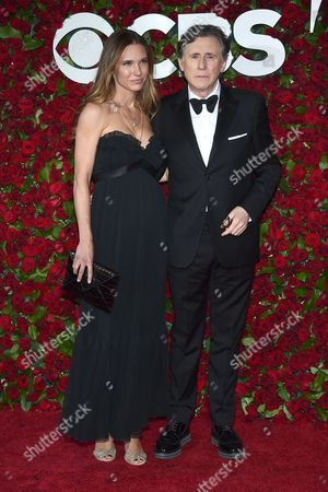 Hannah Beth King, left, and Gabriel Byrne arrive at the Tony Awards at the Beacon Theatre, in New York