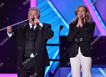 Dan Dotson, left, and Rene Russo present the lifetime achievement award at the 20th annual Critics' Choice Movie Awards at the Hollywood Palladium, in Los Angeles