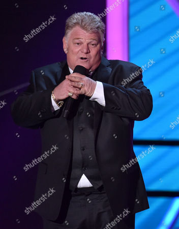 Dan Dotson presents the lifetime achievement award at the 20th annual Critics' Choice Movie Awards at the Hollywood Palladium, in Los Angeles