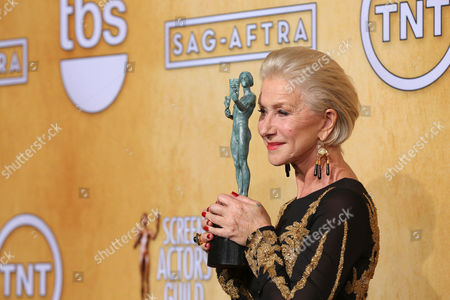 Stock Picture of Helen Mirren poses in the press room with the award for outstanding performance by a female actor in a television movie or miniseries for Phil Spector at the 20th annual Screen Actors Guild Awards at the Shrine Auditorium, in Los Angeles