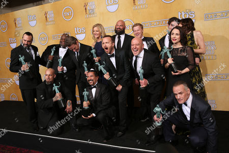 """From left, back row Patrick Sane, Lavell Crawford, Bryan Cranston, Anna Gunn, Aaron Paul, Matthew T. Metzler, Jesse Plemons, Dean Norris, RJ Mitte, Laura Fraser, Betsy Brandt, front from left, Tait Fletcher, Steven Michael Quezada, and Michael Bowen pose in the press room with their awards for outstanding performance by an ensemble in a drama series for """"Breaking Bad"""" at the 20th annual Screen Actors Guild Awards at the Shrine Auditorium, in Los Angeles"""