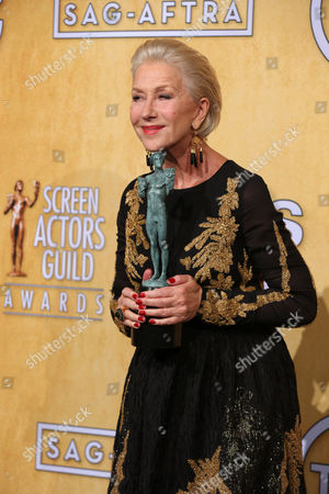 Helen Mirren poses in the press room with the award for outstanding performance by a female actor in a television movie or miniseries for Phil Spector at the 20th annual Screen Actors Guild Awards at the Shrine Auditorium, in Los Angeles