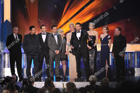 Stock Picture of From left, Robert De Niro, Michael Pena, Alessandro Nivola, Jeremy Renner, Colleen Camp, Elisabeth Rohm, Bradley Cooper, Jennifer Lawrence, Amy Adams, and Paul Herman accept the award for outstanding performance by a cast in a motion picture for American Hustle at the 20th annual Screen Actors Guild Awards at the Shrine Auditorium, in Los Angeles