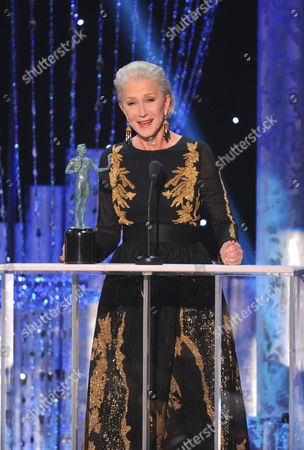 Helen Mirren accepts the award for outstanding performance by a female actor in a television movie or miniseries for Phil Spector at the 20th annual Screen Actors Guild Awards at the Shrine Auditorium, in Los Angeles