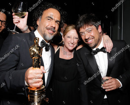 Alejandro González Iñárritu, from left, Claudia Lewis, President of Production, Fox Searchlight, and Alfonso R Gomez are seen at the 20th Century Fox & Fox Searchlight Oscar Party at BOA Steakhouse, in West Hollywood, Calif