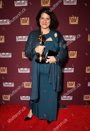 "Anna Pinnock with her award for best production design for ""The Grand Budapest Hotel"" seen at the 20th Century Fox & Fox Searchlight Oscar Party at BOA Steakhouse, in West Hollywood, Calif"