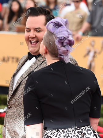 Ross Matthews, left, and Kelly Osbourne arrive at the 21st annual Screen Actors Guild Awards at the Shrine Auditorium, in Los Angeles