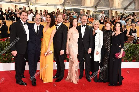 Derek Cecil, from left, Michael Kelly, Mozhan Marno, Jimmi Simpson, Molly Parker, Michael Gill, Jayne Atkinson, Rachel Brosnahan and Joanna Going arrive at the 21st annual Screen Actors Guild Awards at the Shrine Auditorium, in Los Angeles