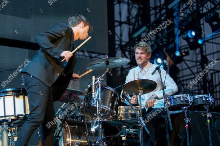 Mark Foster, left, and Mark Pontius of Foster the People performs on stage during the 22nd KROQ Weenie Roast held at the Verizon Wireless Amphitheater on in Irvine, Calif