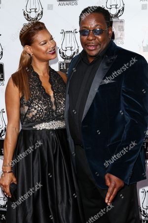 Bobby Brown, right, and Alicia Etheridge attend the 26th Annual Heroes and Legends Awards held at The Beverly Hills Hotel, in Beverly Hills, Calif