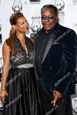 Stock Image of Bobby Brown, right, and Alicia Etheridge attend the 26th Annual Heroes and Legends Awards held at The Beverly Hills Hotel, in Beverly Hills, Calif