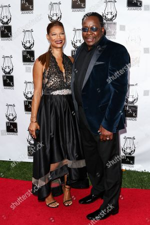 Stock Picture of Bobby Brown, right, and Alicia Etheridge attend the 26th Annual Heroes and Legends Awards held at The Beverly Hills Hotel, in Beverly Hills, Calif
