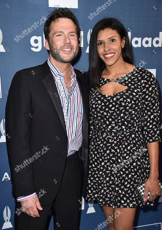 David Millbern, left, and Olivia Harewood arrive at the 27th Annual GLAAD Media Awards at the Beverly Hilton, in Beverly Hills, Calif