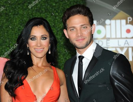 Monica Noguera, left, and Gabriel Coronel attend the press room at the 3rd Annual Billboard Mexican Awards at The Dolby Theatre on in Los Angeles