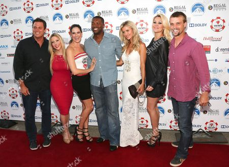 From left, Bob Guiney, Guest, Tiffany Michelle, Roger Cross, Joanna Krupa, Shanna Moakler and Jesse Spencer arrive at The Children's Charity Of Southern California Texas Hold 'Em Poker Tournament hosted by Variety at Paramount Studios on in Los Angeles, California