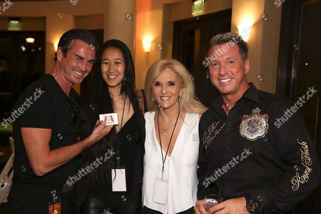 From left, Actor Gary Stretch, Yin Liew, Dr. Estella Sneider and Olav Prinz von Sachsen pose during the 3rd Annual Variety - The Children's Charity of Southern California Texas Hold 'Em Poker Tournament held at Paramount Studios, in Hollywood, California