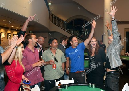 The crowd cheers as actor Eddie Matos (Far right) wins the tournament during the 3rd Annual Variety - The Children's Charity of Southern California Texas Hold 'Em Poker Tournament held at Paramount Studios, in Hollywood, California
