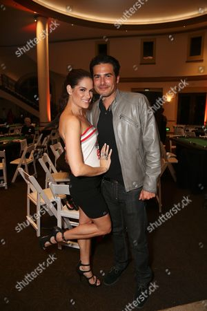 From left, Actress and poker player Tiffany Michelle and actor Eddie Matos pose during the 3rd Annual Variety - The Children's Charity of Southern California Texas Hold 'Em Poker Tournament held at Paramount Studios, in Hollywood, California