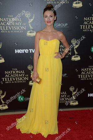 Elizabeth Hendrickson arrives at the 41st annual Daytime Emmy Awards at the Beverly Hilton Hotel, in Beverly Hills, Calif