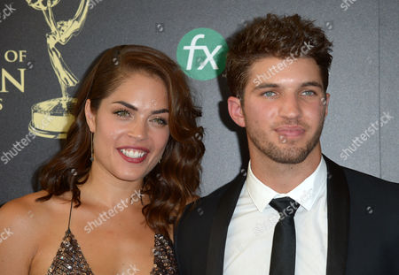 Kelly Thiebaud, left, and Bryan Craig arrive at the 41st annual Daytime Emmy Awards at the Beverly Hilton Hotel, in Beverly Hills, Calif