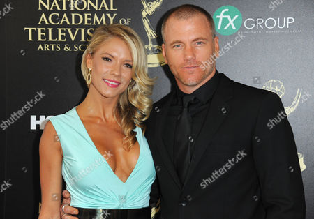 Stock Photo of Suzanne Quast, left, and Sean Carrigan arrive at the 41st annual Daytime Emmy Awards at the Beverly Hilton Hotel, in Beverly Hills, Calif