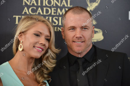 Stock Picture of Suzanne Quast, left, and Sean Carrigan arrive at the 41st annual Daytime Emmy Awards at the Beverly Hilton Hotel, in Beverly Hills, Calif