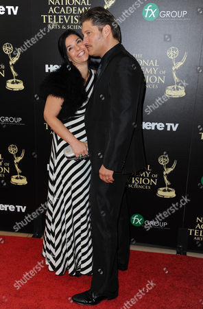 Michele Vega, left, and Sean Kanan arrive at the 41st annual Daytime Emmy Awards at the Beverly Hilton Hotel, in Beverly Hills, Calif