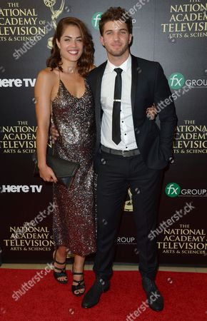 Stock Picture of Kelly Thiebaud, left, and Bryan Craig arrive at the 41st annual Daytime Emmy Awards at the Beverly Hilton Hotel, in Beverly Hills, Calif