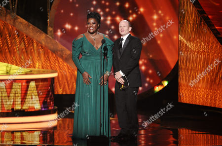 SEPTEMBER 18: Loretta Devine (L) and Paul McCrane onstage at the Academy of Television Arts & Sciences 63rd Primetime Emmy Awards at Nokia Theatre L.A. Live on in Los Angeles, California