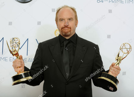 "Stock Picture of Comedian Louis C. K., winner Outstanding Writing For A Comedy Series for ""Louie"", poses backstage at the 64th Primetime Emmy Awards at the Nokia Theatre, in Los Angeles"