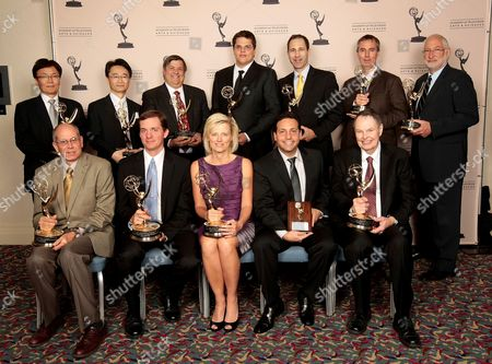 HOLLYWOOD, CA - OCTOBER 24: The 2012 Enineering Awards recipients (Back Row L-R) Fukaishi Akira, Oshima San, Gary Mandle, Mark Jaszberenyi, Matt Marenghi, Trevor Davies, Stephen Lighthill (Front Row (L-R) Ray Feeney, Peter Postma, Kim Snyder, Todd Greenbaum and Richard Green at the Academy of Television Arts & Sciences 64th Primetime Emmy Engineering Awards at the Loews Hollywood Hotel on in Hollywood, California