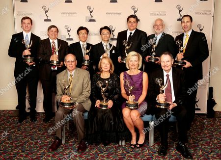 HOLLYWOOD, CA - OCTOBER 24: The 2012 Enineering Awards recipients (Back Row L-R) Peter Postma, Gary Mandle, Fukaishi Akira, Oshima San, Mark Jaszberenyi, Stephen Lighthill, Matt Marenghi, (Front Row (L-R) Ray Feeney, Joan Vogelsang, Kim Snyder and Richard Green at the Academy of Television Arts & Sciences 64th Primetime Emmy Engineering Awards at the Loews Hollywood Hotel on in Hollywood, California