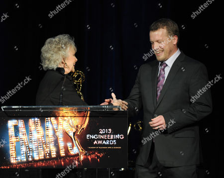 From left, actress June Lockhart presents the Emmy Engineering Award to YouTube Engineering Director, Jason Gaedtke onstage at the 65th Primetime Emmy Engineering Awards,, at Loews Hollywood Hotel, in Hollywood, Calif