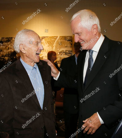 Stock Image of Haskell Wexler, left, and Garrett Brown attend the 67th Engineering Emmy Awards at the Loews Hollywood Hotel, in Los Angeles