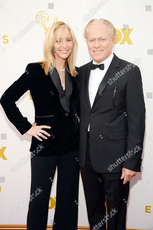 Lisa Kudrow, left, and Michael Stern arrive at the 67th Primetime Emmy Awards, at the Microsoft Theater in Los Angeles