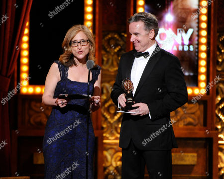 Erika Mallin and James Houghton of Signature Theater, accept the Regional Theatre Award on stage at the 68th annual Tony Awards at Radio City Music Hall, in New York