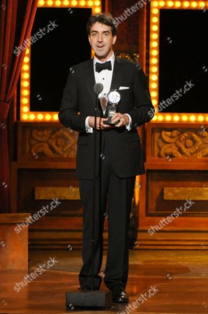 "Jason Robert Brown accepts the award for best orchestrations for ""The Bridges of Madison County"" on stage at the 68th annual Tony Awards at Radio City Music Hall, in New York"