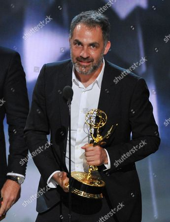 """Miguel Sapochnik accepts the award for outstanding directing for a drama series for """"Game of Thrones"""" at the 68th Primetime Emmy Awards, at the Microsoft Theater in Los Angeles"""