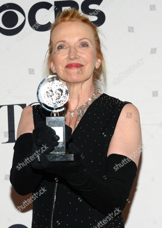 """Catherine Zuber poses with the award for best costume design of a musical for """"The King and I"""" in the press room at the 69th annual Tony Awards at Radio City Music Hall, in New York"""