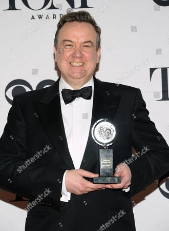 Richard McCabe poses in the press room the award for best performance by an actor in a featured role in a play for the Audience at the 69th annual Tony Awards at Radio City Music Hall, in New York