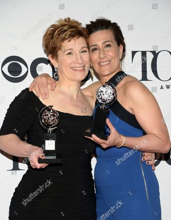 Lisa Kron, left, and Jeanine Tesori pose with the award for best score for Fun Home in the press room at the 69th annual Tony Awards, in New York