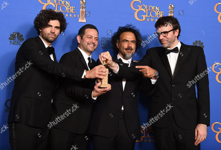 Armando Bo, from left, Alexander Dinelaris Jr., Alejandro Gonzalez Inarritu, and Nicolas Giacobone pose in the press room with the award for best screenplay for Birdman at the 72nd annual Golden Globe Awards at the Beverly Hilton Hotel, in Beverly Hills, Calif