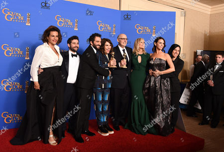 Alexandra Billing, from left, Joe Lewis, Jay Duplass, Jill Soloway, Jeffrey Tambor, Judith Light, Amy Landecker and Andrea Sperling pose in the press room with the award for best actor in a television series - musical or comedy for Transparent at the 72nd annual Golden Globe Awards at the Beverly Hilton Hotel, in Beverly Hills, Calif