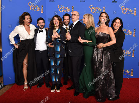 Alexandra Billing, from left, Joe Lewis, Jill Soloway, Jay Duplass, Jeffrey Tambor, Judith Light, Amy Landecker, and Andrea Sperling pose in the press room with the award for best actor in a television series - musical or comedy for Transparent at the 72nd annual Golden Globe Awards at the Beverly Hilton Hotel, in Beverly Hills, Calif